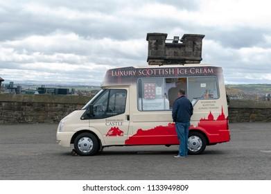 Edinburgh, Scotland - April 2018: Handmade Scottish confectionery and ice cream vending van at the Esplanade in front of Gatehouse, the main entrance to Edinburgh Castle, Scotland, UK