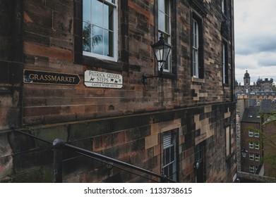 Edinburgh, Scotland - April 2018: Patrick Gedges Steps and Grassmarket signages on a building wall in Old Town Edinburgh, Scotland, UK