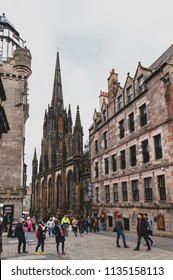 Edinburgh, Scotland - April 2018: Royal Mile, touristic street of Old Town Edinburgh City in Scotland, with Tron Kirk, former gothic church, now The Hub, a venue for various events and festivals