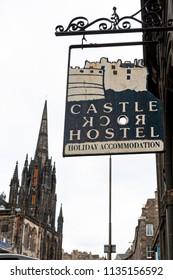 Edinburgh, Scotland - April 2018: Sign in front of Castle Rock Hostel on Royal Mile in Scotland with Tron Kirk, former gothic church, now The Hub, a venue for various events and festivals