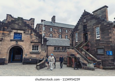 Edinburgh, Scotland - April 2018: Tourists exploring group of old buildings which house Museum of The Royal Regiment for Scotland located inside Edinburgh Castle, Scotland, UK