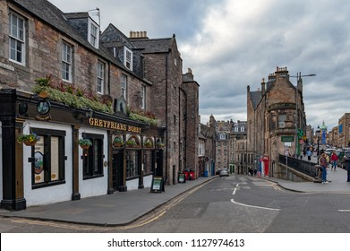 Edinburgh, Scotland - April 2018: View from George IV Bridge towards Candlemaker Row Street alongside with historic buildings in city center of Edinburgh, Scotland, UK