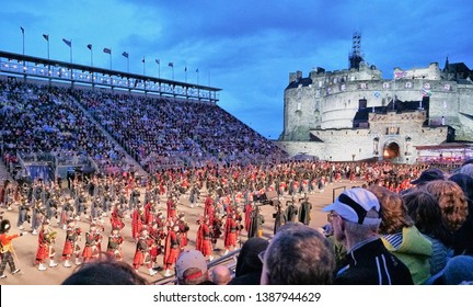 Edinburgh, Scotland - Aug 2016: Wide angle view of the iconic Military Tattoo performers in the stadium in front of the Edinburgh Castle with spectators looking on from the bleachers.