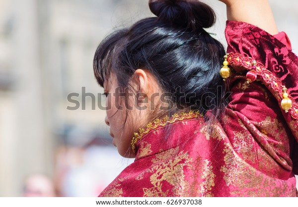 EDINBURGH, SCOTLAND - AUGUST 13, 2016: Member of the Hsu Chen Wei Production Dance Company performs The Sacrifice of Roaring to the general public on the streets of Edinburgh