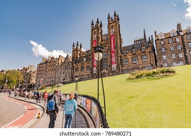 Edinburgh, Scotland - August 14 2017: superb panorama of the city of Edinburgh in Scotland England with people walking in the central streets and dark buildings