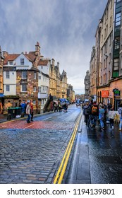 Edinburgh, Scotland - August 14, 2018:  Pedestrians walk along the Royal MIle, a sequence of streets forming the main thoroughfare of the Old Town of the city of Edinburgh.