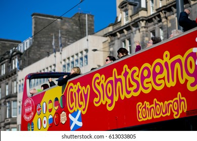 Edinburgh, Scotland - August 22, 2014: Red double-decker bus tour with an open top is a great transportation for tourist to exploring Edinburgh city.