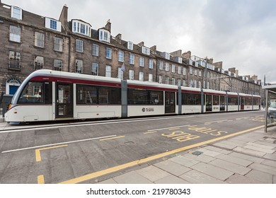 EDINBURGH, SCOTLAND: AUGUST 3, 2014: Edinburgh Tram on station. Tram line is 14 kilometer long and it connects York Place and Edinburgh Airport with 15 stops.