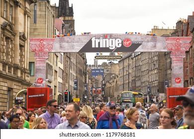 EDINBURGH, SCOTLAND - August 3, 2018: Flocks of people walking on Royal Mile during Fringe Festival 2018, biggest art festival in the world.