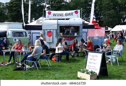 EDINBURGH, SCOTLAND - AUGUST 6, 2016 : Foodie Festival in Edinburgh, the UK's biggest food festival. Customers seated in front of food outlets