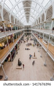 EDINBURGH, SCOTLAND  - AUGUST 7: Visitors view exhibits on multiple levels of the Grand Gallery of the National Museum of Scotland. August 7, 2018 in Edinburgh, Scotland.