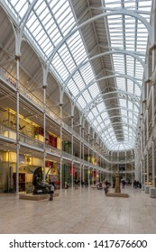 EDINBURGH, SCOTLAND  - AUGUST 7: Visitors view exhibits in the Grand Gallery of the National Museum of Scotland. August 7, 2018 in Edinburgh, Scotland.