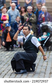 EDINBURGH, SCOTLAND: AUGUST 8, 2014: Artist performing on Fringe festival. Fringe is the very popular and largest arts festival in the world.