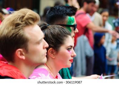 EDINBURGH, SCOTLAND - AUGUST 8, 2015: Male and female performers on the Royal Mile during the Edinburgh International Fringe Festival