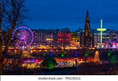 Edinburgh Scotland bright lights night life. City landscape celebration mood