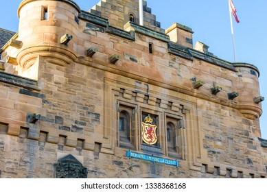 Edinburgh, Scotland - Dec 2018. View of a detail of the Edinburgh Castle with the Emblem and the Scottish National Motto in Latin 'Nemo me impune lacessit', meaning 'no one provokes me with impunity'.