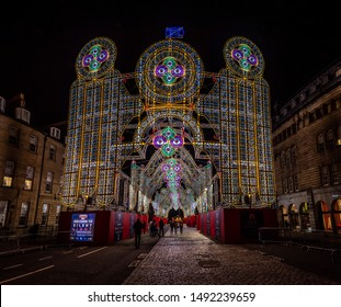 EDINBURGH, SCOTLAND DECEMBER 13, 2018: Silent disco at the at christmas time, full of shiny colorful lights