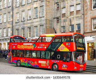 EDINBURGH, SCOTLAND - DECEMBER 31, 2016 : Colorful hop on - hop off city sightseeing tour bus in Edinburgh, Scotland