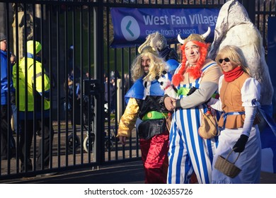 EDINBURGH, SCOTLAND - February 12, 2018 - Three French supporters dressed as Asterix and Obelix for the Rugby 6 Nations match between France and Scotland. Murrayfield, Edinburgh.