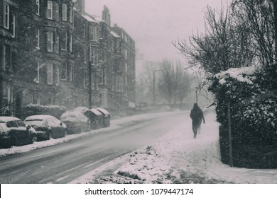 EDINBURGH, SCOTLAND - February 28, 2018: Person walking in the streets in Edinburgh under snow, during the Beast from the East weather episode.
