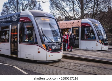 Edinburgh, Scotland - January 17, 2020: Tramcars on tram stop on Princes Street in Edinburgh city