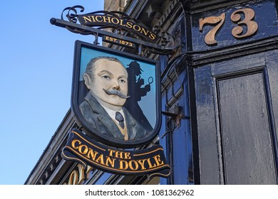 EDINBURGH, SCOTLAND - JULY, 16, 2017: Sign of the well-known Conan Doyle Pub in Edinburgh, named after Sir Arthur Conan Doyle, the creator of the famous detective Sherlock Holmes.
