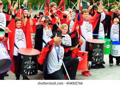 EDINBURGH, SCOTLAND - JULY 17, 2016: Pulse of the Place, a youth samba band before their performance at the Carnival of The Edinburgh Jazz and Blues Festival, Thumbs Up