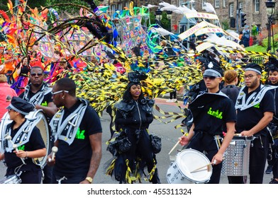 EDINBURGH, SCOTLAND - JULY 17, 2016: Performers in the Carnival of The Edinburgh Jazz and Blues Festival travel down the Mound towards Princes Street