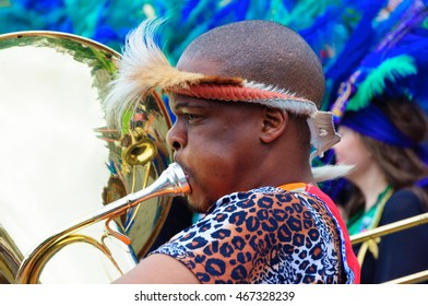 EDINBURGH, SCOTLAND - JULY 17, 2016: Closeup of a male musician performing in the Carnival of The Edinburgh Jazz and Blues Festival travelling down the Mound towards Princes Street