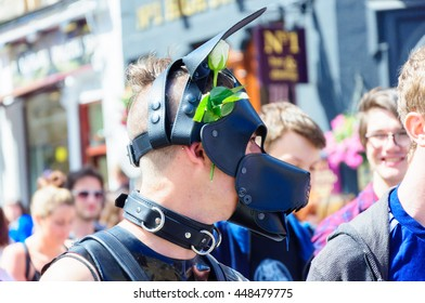 EDINBURGH, SCOTLAND - JULY 2, 2016: Closeup of a man wearing a dog mask and collar celebrating Pride Edinburgh on the march along the Royal Mile during Scotland's National LGBTI Festival.