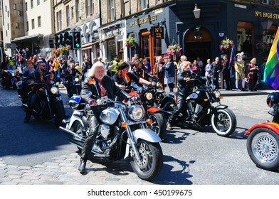 EDINBURGH, SCOTLAND - JULY 2, 2016: A group of bikers on motorcycles without crash helmets celebrating Pride Edinburgh riding along the Royal Mile during Scotland's National LGBTI Festival.