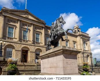 EDINBURGH, SCOTLAND: JULY 26: Duke of Wellington statue on July 26, 2017 in Edinburgh, Scotland.  The Scottish archives are located in the background..