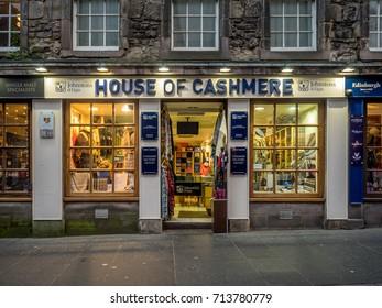 EDINBURGH, SCOTLAND - JULY 28: Tourist shops along the Royal Mile on July 28, 2017 in Edinburgh, Scotland. There are many such shops on the Royal Mile serving tourists with kilts, shirts, etc.