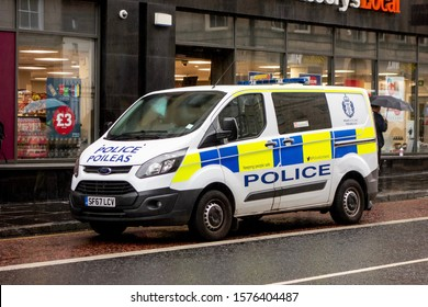 EDINBURGH, SCOTLAND - JULY 29, 2019: White Ford Transit Custom van of the Police Scotland on a patrol mission on streets