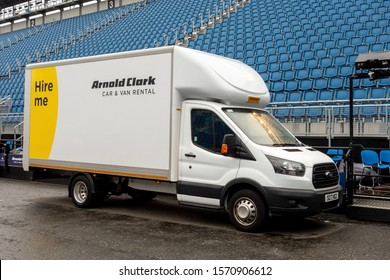EDINBURGH, SCOTLAND - JULY 29, 2029: White Ford Transit chassis van hired from the Arnold Clark car rental company parked at the Esplanade stadium near the Edinburgh Castle during preparing some event