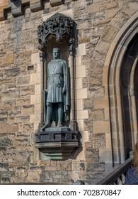 EDINBURGH, SCOTLAND - JULY 29: Robert Bruce statue at entrance to  Edinburgh Castle on July 29, 2017 in Edinburgh Scotland. Edinburgh Castle is full of many ancient buildings.