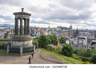 EDINBURGH, SCOTLAND - JUN12, 2017: People travel to see view of Edinburgh city on Dugald Stewart Monument at dusk.
