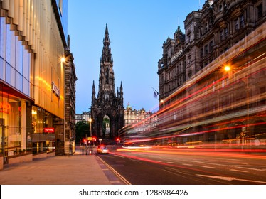 Edinburgh / Scotland — June 18, 2018: a night view of the Walter Scott monument in the New Town of Edinburgh from Frederick Street with the traffic. A gothic spire is one of the landmarks of the city