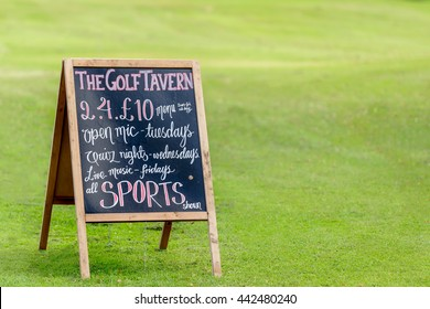EDINBURGH, SCOTLAND -  JUNE 20, 2016: An advertising board for The Golf Tavern in Edinburgh.  The tavern is one of the oldest public houses established in 1456.
