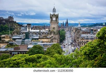 Edinburgh / Scotland - June 20, 2018: panoramic view of Princess street and Edinburgh Castle from the Calton Hill