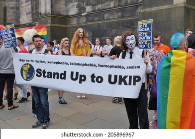 """EDINBURGH, SCOTLAND --JUNE 22, 2014 -- The """"gay pride"""" in Edinburgh displays signs both in favor and against Scottish independence to be voted on at the September 18, 2014 referendum."""