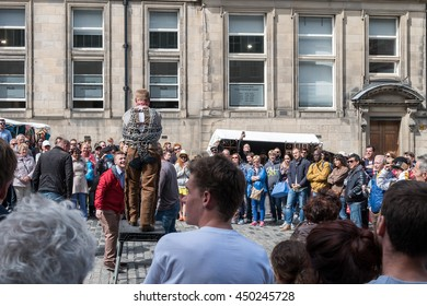 Edinburgh ,Scotland - June 30 : Street show , Man bind himself with chain  on June 30 2016  in Mainstreet of Edinburgh ,Scotland