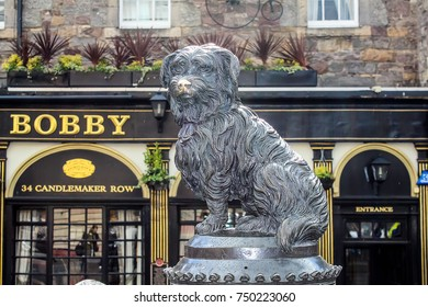 Edinburgh, Scotland - June 5, 2015: Sculpture of Greyfriars Bobby was a Skye Terrier which became known for supposedly spending 14 years guarding the grave of its owner