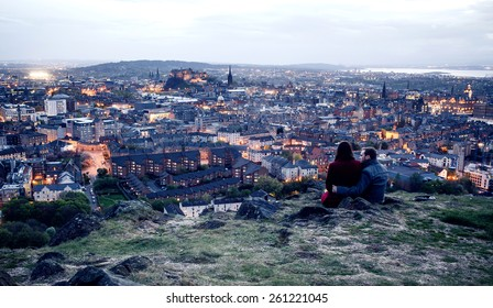 EDINBURGH, SCOTLAND - MAY 06, 2014: Couple on hill in Edinburgh. Edinburgh is the capital city and second most populous city in Scotland.