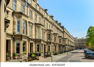 EDINBURGH, SCOTLAND - MAY 10, 2016: Prime residential property in Rothesay Terrace in the west end of Edinburgh.  The buildings are constructed with Blonde sandstone.