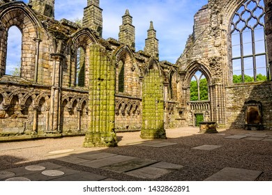 Edinburgh, Scotland - May 12, 2019: Holyrood Abbey is a ruined abbey of the Canons Regular in Ediinburgh, Scotland