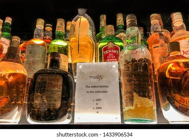 Edinburgh, Scotland - May 12, 2019:  Oldest whisky bottles on display at the Scotch Whisky Experience in Edinburgh, Scotland.