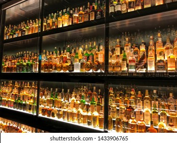 Edinburgh, Scotland - May 12, 2019:  The Diageo Claive Vidiz Collection of 3.384 bottles of whiskey, displayed at the Scotch Whisky Experience in Edinburgh, Scotland.