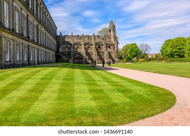 Edinburgh, Scotland - May 12, 2019:  Manicured landscaped grounds of the Holyrood Palace in Edinburgh.