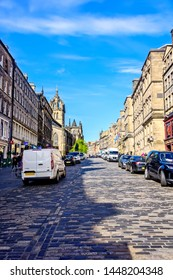 Edinburgh, Scotland - May 12, 2019:  The Royal Mile is a combination of streets forming the main thoroughfare of the Old Town of the city of Edinburgh in Scotland.